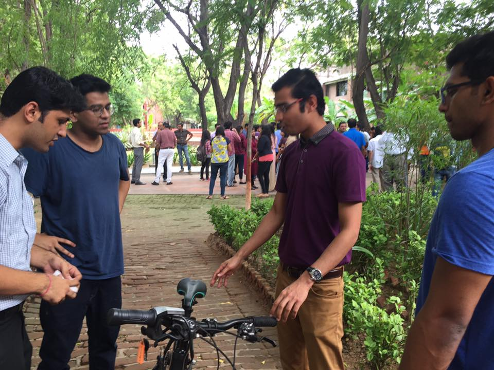 Lightspeed demonstrating their e-bike prototype and collecting feedback from university students in Ahmedabad.