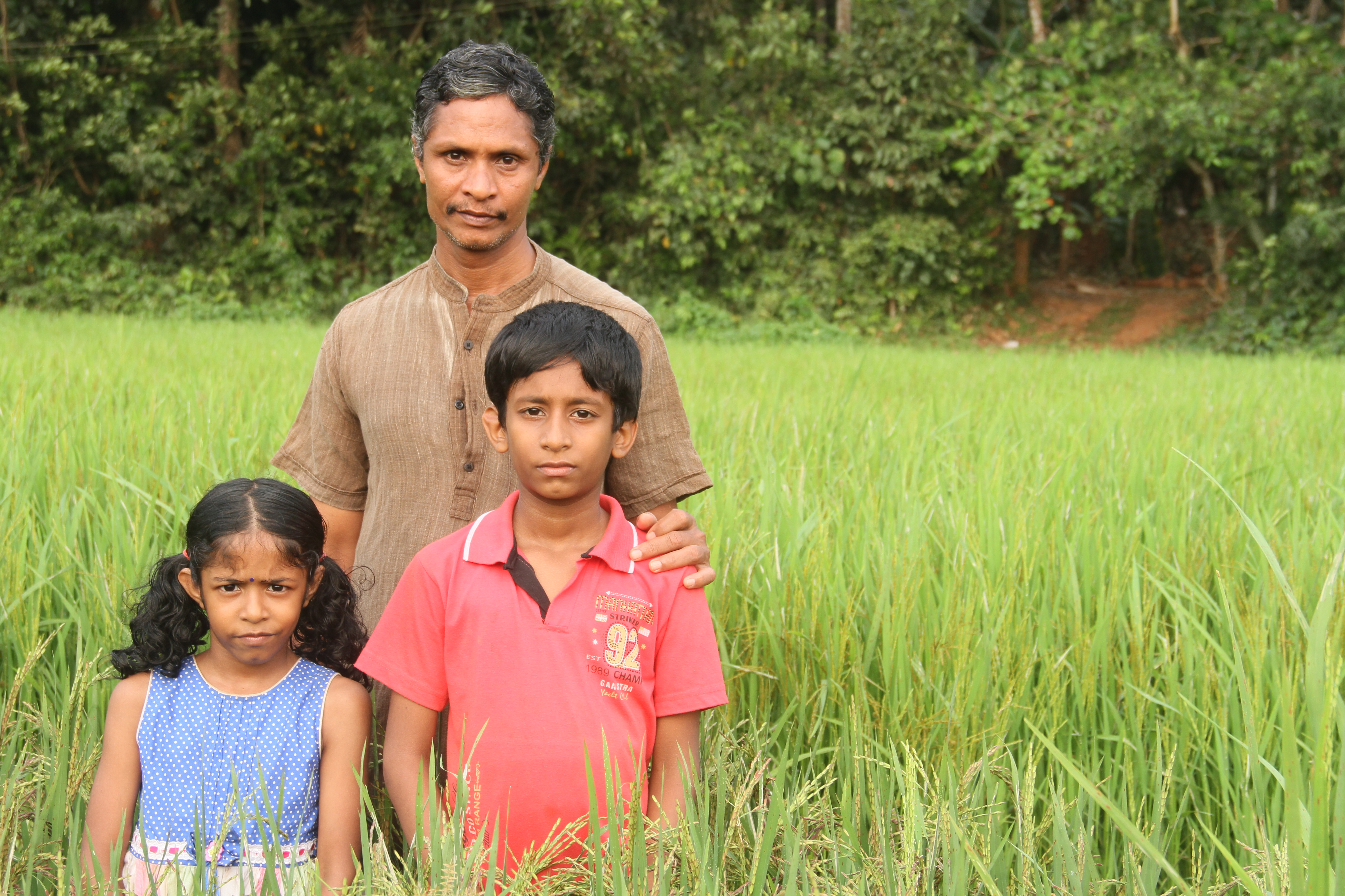 Jayakrishnan, conservator of 118 rare rice varieties, with his children